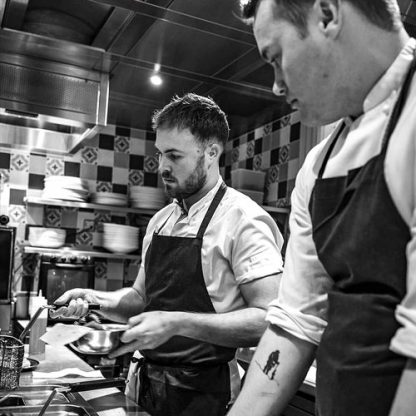 Chefs Will Murray and Jack Croft cooking in their Mayfair Restaurant, Fallow